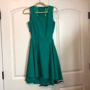 Green dress with open-back cutout